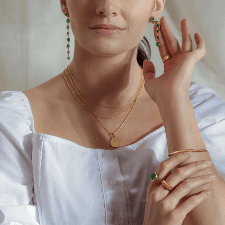 Minimalist Gold Jewelry On A Model